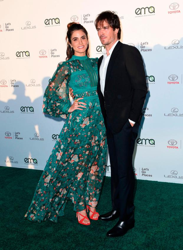 Nikki Reed and Ian Somerhalder attend the 27th annual EMA (Environmental Media Association) awards at the Barker Hangar in Santa Monica, on September 23, 2017. / AFP PHOTO / CHRIS DELMASCHRIS DELMAS/AFP/Getty Images