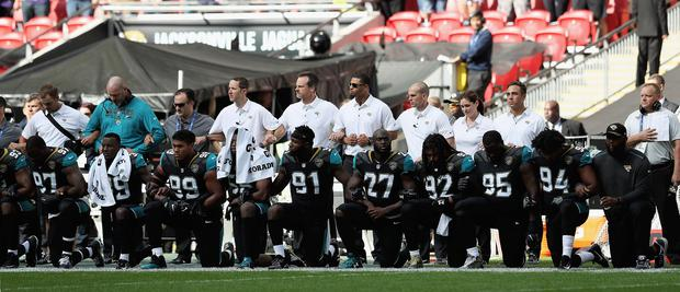 Jacksonville Jaguar players show their protest during the National Anthem during the NFL International Series match between Baltimore Ravens and Jacksonville Jaguars at Wembley Stadium on September 24, 2017 in London, England. (Photo by Matthew Lewis/Getty Images)
