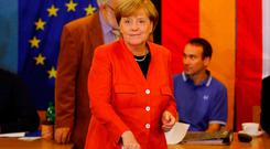 German Chancellor and leader of the Christian Democratic Union CDU Angela Merkelvotes in the generalelection (Bundestagswahl)in Berlin, Germany, September 24, 2017. REUTERS/Kai Pfaffenbach