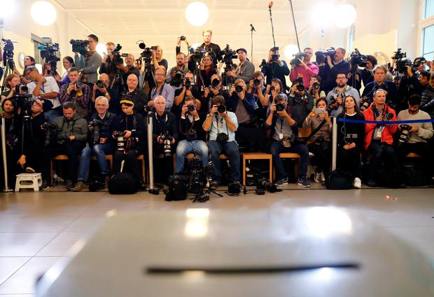 Members of the media wait at a polling station where German Chancellor and leader of the Christian Democratic Union CDU Angela Merkel will vote in the general election (Bundestagswahl) in Berlin, Germany, September 24, 2017. REUTERS/Fabrizio Bench