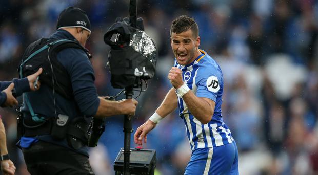 Goalscorer Tomer Hemed of Brighton and Hove Albion celebrates for the television camera after the Premier League match between Brighton and Hove Albion and Newcastle United at Amex Stadium on September 24, 2017 in Brighton, England. (Photo by Catherine Ivill - AMA/Getty Images)