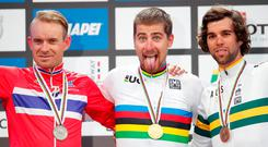 Peter Sagan (centre) celebrates his Road World Championships victory with silver medalist Alexander Kristoff (left) of Norway and bronze medalist from Australia Michael Matthews. Photo: Reuters