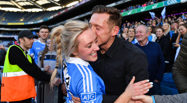 Dublin footballer Paul Flynn kisses his fiancée Fiona Hudson after the TG4 Ladies Football All-Ireland Senior Championship Final match between Dublin and Mayo at Croke Park in Dublin. Photo by Brendan Moran/Sportsfile