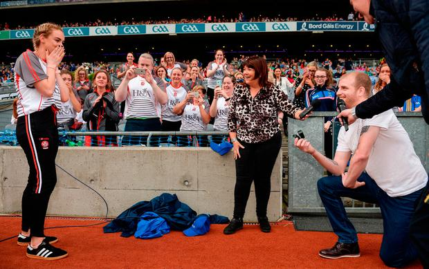 Ryan McCloskey proposes to Derry's Ciara McGurk following the TG4 Ladies Football All-Ireland Junior Championship Final match between Derry and Fermanagh at Croke Park. Photo: Cody Glenn/Sportsfile