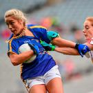 Aisling McCarthy of Tipperary holds off the challenge of Tyrone's Shannon Cunningham during yesterday's intermediate final. Photo: Cody Glenn/Sportsfile