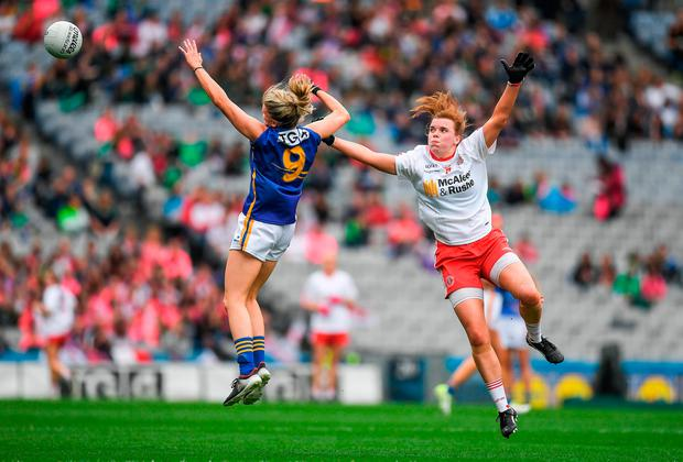 Tipperary's Jennifer Grant battles for possession with Tyrone's Niamh O'Neill. Photo: Brendan Moran/Sportsfile