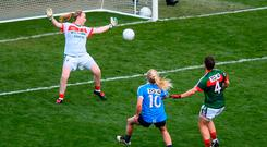 Carla Rowe fires homes Dublin's third goal past Mayo goalkeeper Yvonne Byrne. Photo: Stephen McCarthy/Sportsfile