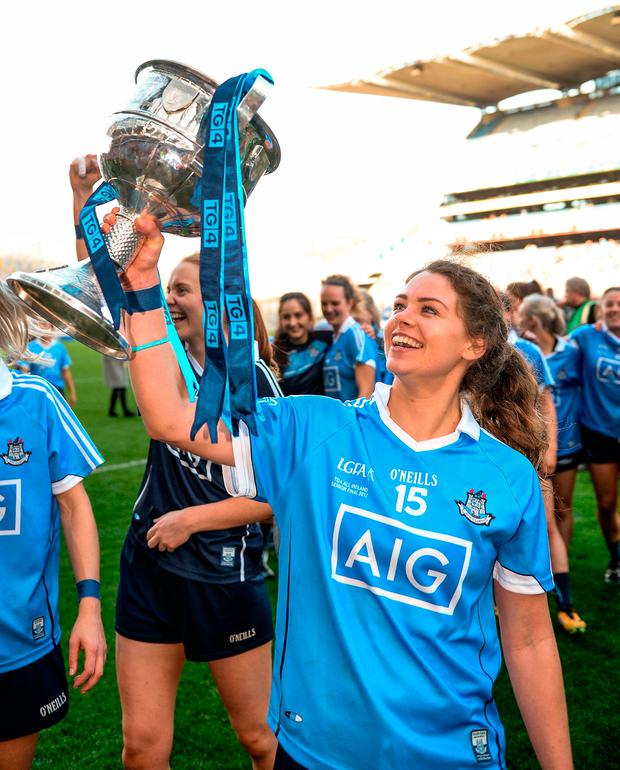 Noelle Healy celebrates with the trophy following Dublin's victory in the TG4 Ladies Football All-Ireland SFC final. Photo: Cody Glenn/Sportsfile