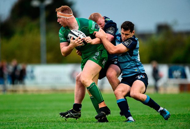 Shane Delahunt of Connacht is tackled by Keiron Assiratti and Tomos Williams of Cardiff. Photo by Diarmuid Greene/Sportsfile
