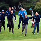 Castlebar's Dave Walsh leads the charge at the 18th green after victory over Warrenpoint in the final of the AIG Jimmy Bruen Shield at Carton House. Picture by Pat Cashman