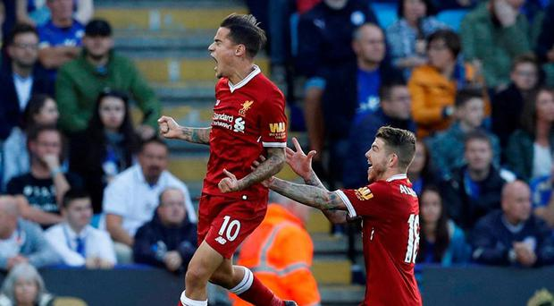 Liverpool's Philippe Coutinho celebrates scoring their second goal with Alberto Moreno. Photo: Darren Staples/Reuters