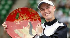 Wozniacki converted her third match point to break once more and secure victory in the 12th game of the set. Photo: Reuters
