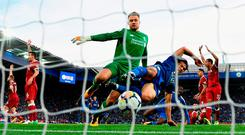 Shinji Okazaki forces the ball home for Leicester City's second goal despite the efforts of Simon Mignolet. Photo: Laurence Griffiths/Getty Images