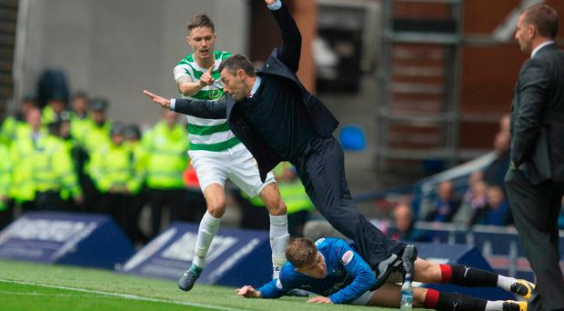 Rangers Josh Windass collides with manager Pedro Caixinha at Ibrox. Photo credit: Jeff Holmes/PA Wire.