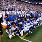 Members of the Indianapolis Colts take a knee during the nation anthem before an NFL football game against the Cleveland Browns in Indianapolis, Sunday, Sept. 24, 2017. (AP Photo/Darron Cummings)