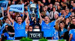 Dublin players Niamh McEvoy, left, and Nicole Owens celebrate with the Brendan Martin Cup after the TG4 Ladies Football All-Ireland Senior Championship Final match between Dublin and Mayo at Croke Park in Dublin. Photo by Brendan Moran/Sportsfile