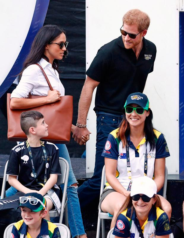 Britain's Prince Harry (R) arrives with girlfriend actress Meghan Markle at the wheelchair tennis event during the Invictus Games in Toronto, Ontario, Canada September 25, 2017. REUTERS/Mark Blinch