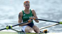 Old Collegians sculler Sanita Puspure put in a storming finish to narrow the gap on Swiss champion Jeannine Gmelin in their heat of the women's singles. Photo: Ramsey Cardy/Sportsfile
