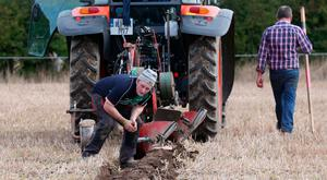 James Shine from Kilkenny, a competitor in Under 28 Conventional Class Senior inspects his work at the National Ploughing Championships in Screggan, Co Offaly last week. Photo: Laura Hutton/Collins Photo Agency