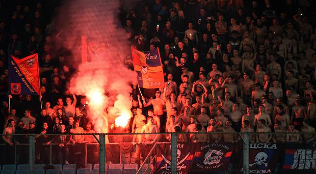 CSKA Moscow supporters light flares at the Arena Khimki Stadium, Khimki, Russia. Photo: Epsilon/Getty Images