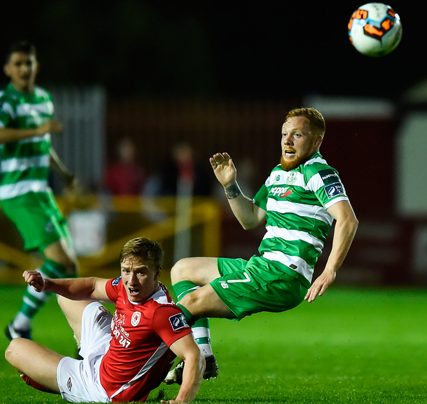 Shamrock Rovers' Ryan Connolly is tackled by St Patrick's Athletic's Paul O'Conor. Photo: Sportsfile