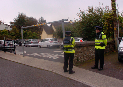 Gardaí sealed off a car park near the house. Photo: Provision
