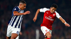 Arsenal's Alexis Sanchez stays ahead of West Brom's Jake Livermore. Photo: Getty Images