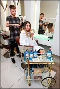 Elisa Teyssier from Meath enjoying a gin and tonic while getting her hair done by Craig Fitzpatrick at Brown Sugar in South William Street, Dublin. Photo: Steve Humphreys