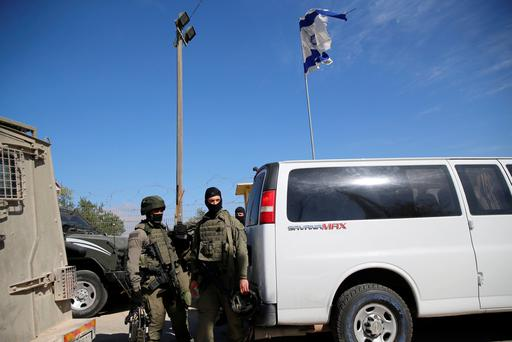 Israeli soldiers guard near the scene where a police spokeswoman said a Palestinian gunman killed three Israelis guards and wounded a fourth in an attack on a Jewish settlement in the occupied West Bank before he was shot dead, September 26, 2017. REUTERS/Ammar Awad
