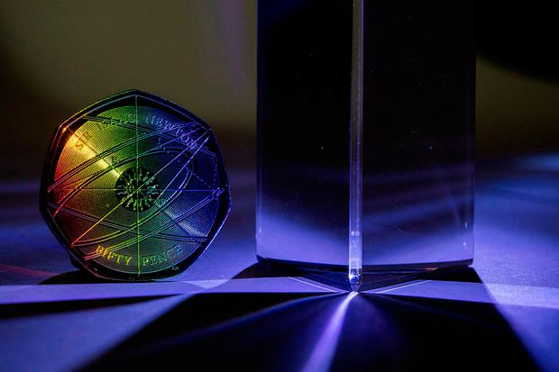 50p coin marking the 375th anniversary of the birth of Sir Isaac Newton next to a prism Credit: CPG Photography Ltd/The Royal Mint/PA Wire