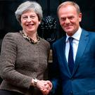 Prime Minister Theresa May greets President of the European Council Donald Tusk at 10 Downing Street in London, ahead of talks Credit: Jonathan Brady/PA Wire