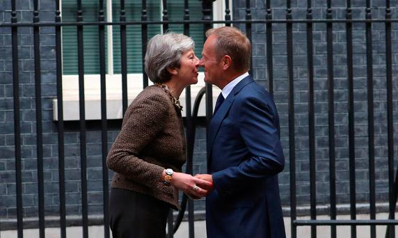 Britain's Prime Minister Theresa May greets Donald Tusk, President of the European Council, outside 10 Downing Street in London, September 26, 2017. REUTERS/Hannah McKay