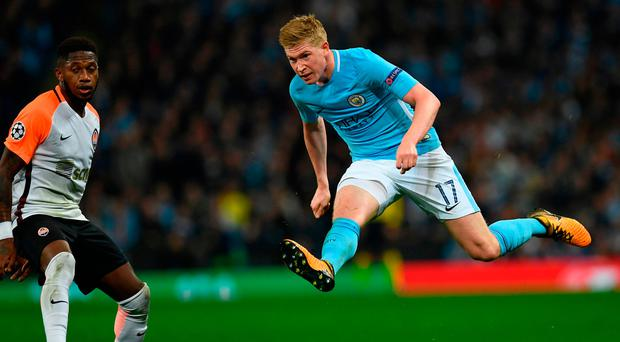 Shakhtar Donetsk's Brazilian midfielder Fred (L) reacts as Manchester City's Belgian midfielder Kevin De Bruyne watches his shot go wide during the Group F football match between Manchester City and Shakhtar Donetsk at the Etihad Stadium in Manchester, north west England, on September 26, 2017. / AFP PHOTO / Paul ELLISPAUL ELLIS/AFP/Getty Images