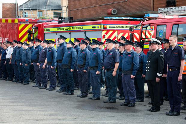 Fire officers stand to attention in memory of colleagues Mark O'Shaughnessy and Brian Murray, who died 10 years ago. Photo: Tony Gavin