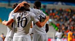 Tottenham Hotspur striker Harry Kane (C) celebrates with his teammates, Son Heung-min (L) and Moussa Sissoko (R). Photo: Getty Images