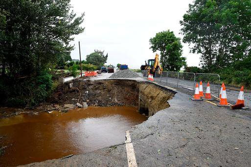 Heavy rain and flooding washed away a section of main road in Quigley's Point, Co Donegal. Photo: Clodagh Kilcoyne/Reuters