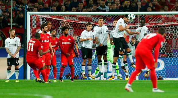 Fernando curls the ball over the Liverpool wall to put Spartak Moscow in front. Photo: Reuters