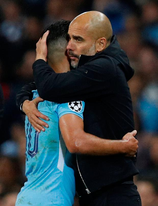 Manchester City's Sergio Aguero with manager Pep Guardiola as he is substituted. Photo: Reuters