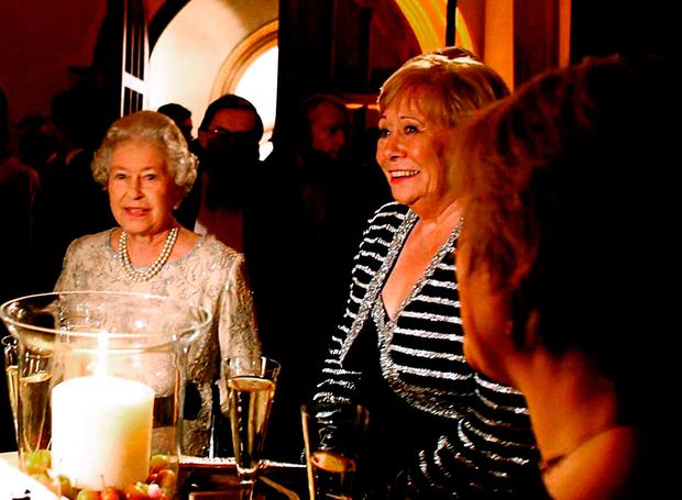 Liz Dawn with the Queen in 2005. Photo: PA
