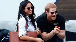 Britain's Prince Harry and his girlfriend actress Markle watch the wheelchair tennis event during the Invictus Games in Toronto, Ontario, Canada September 25, 2017. REUTERS/Mark Blinch