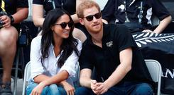 Britain's Prince Harry (R) sits with girlfriend actress Meghan Markle to watch a wheelchair tennis event during the Invictus Games in Toronto, Ontario, Canada September 25, 2017. REUTERS/Mark Blinch
