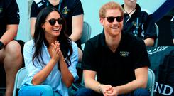 Prince Harry and Meghan Markle watch Wheelchair Tennis at the 2017 Invictus Games in Toronto, Canada. PRESS ASSOCIATION Photo. Picture date: Monday September 25, 2017. Photo credit should read: Danny Lawson/PA Wire
