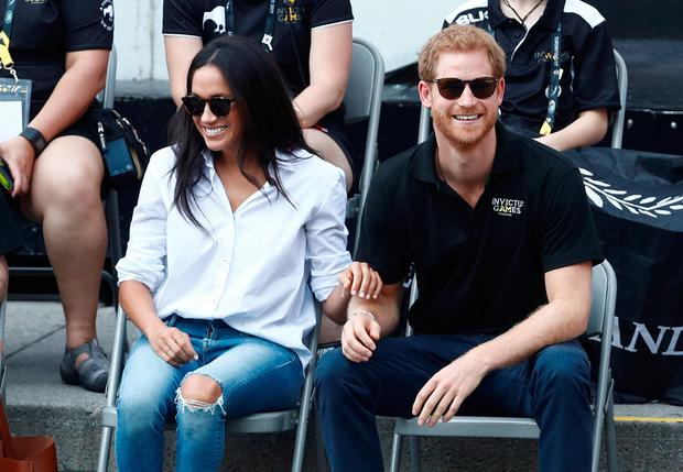 Britain's Prince Harry (R) arrives with girlfriend actress Meghan Markle to watch a wheelchair tennis event during the Invictus Games in Toronto, Ontario, Canada September 25, 2017. REUTERS/Mark Blinch