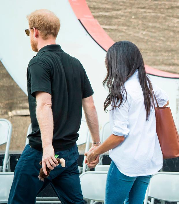 Prince Harry and Meghan Markle attend a Wheelchair Tennis match at the 2017 Invictus Games in Toronto, Canada