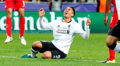 Liverpool's Roberto Firmino looks dejected
