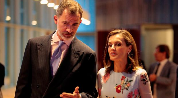 Spain's King Felipe and Queen Letizia speak during the inauguration of the Palma Conference center in Palma de Mallorca, Spain, September 25, 2017. REUTERS/Enrique Calvo