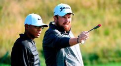 Robin Tiger Williams. the youug amateur, getting some tips from Ireland's Shane Lowry during a practice round prior to the British Masters at Close House Golf Club