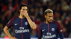 Paris Saint-Germain's Uruguayan forward Edinson Cavani (L) and Paris Saint-Germain's Brazilian forward Neymar react during the French Ligue 1 football match between Paris Saint-Germain (PSG) and Lyon (OL) on September 17, 2017 at the Parc des Princes stadium in Paris. (Photo by Mehdi Taamallah/NurPhoto via Getty Images)