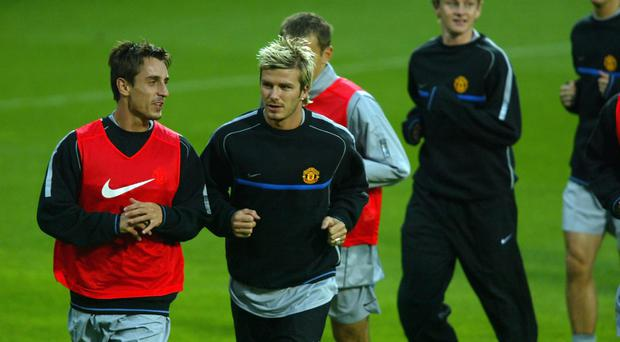 David Beckham and Gary Neville of Manchester United during their training session before the Champions League First Stage match between Bayer Leverkusen and Manchester United at The Bay Arena in Leverkusen, Germany on September 23, 2002. (Photo By Ben Radford/Getty Images)