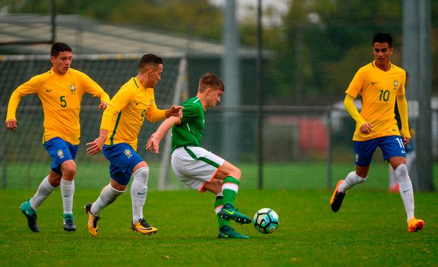 Seamas Keogh of Republic of Ireland in action against Brazil's, from left, Fabinho, Joao Peglow, and Reiner. Photo by Piaras Ó Mídheach/Sportsfile